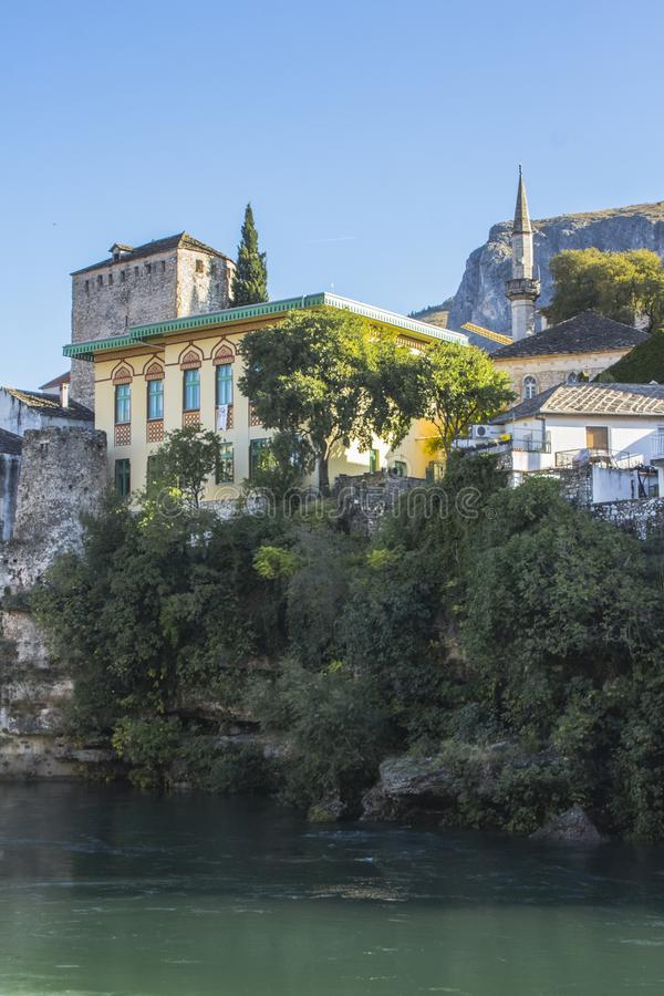 Beautiful historic houses on the banks of the Neretva River in the Old Town of Mostar. Bosnia and Herzegovina.  royalty free stock image