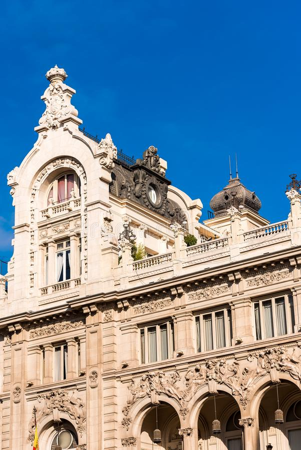 Beautiful historical building of old architecture in the city center, Madrid, Spain. Copy space for text. Vertical. Beautiful historical building of old stock image