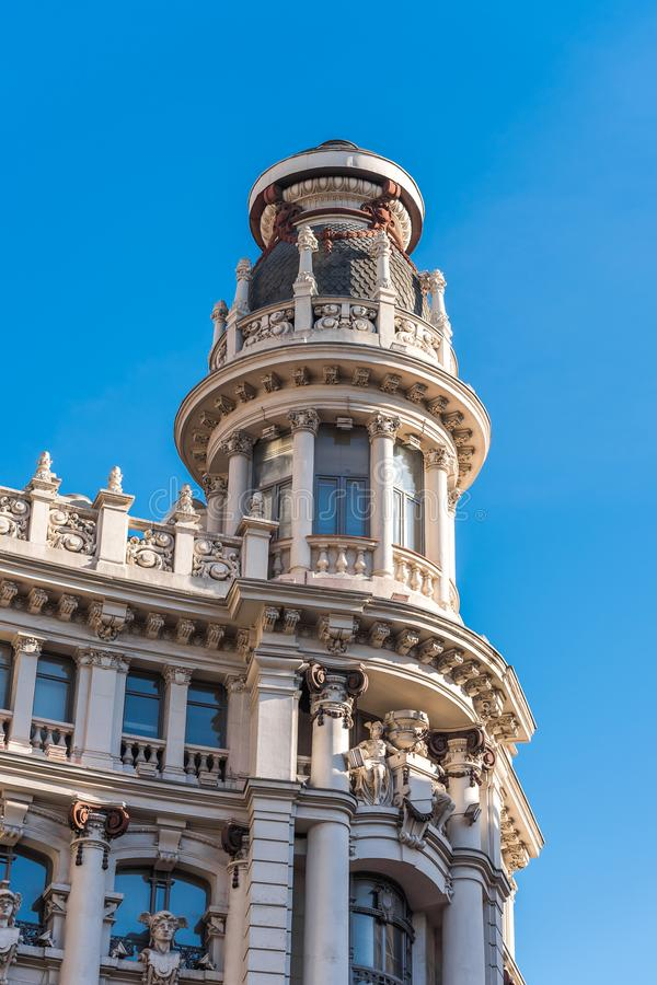 Beautiful historical building of old architecture in the city center, Madrid, Spain. Copy space for text. Vertical. Beautiful historical building of old royalty free stock image