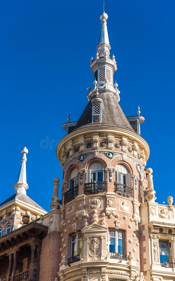 Beautiful historical building of old architecture in the city center, Madrid, Spain. Copy space for text. Vertical. Beautiful historical building of old royalty free stock photography