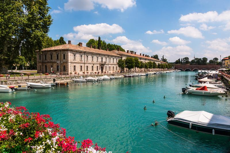 The beautiful historical harbor of Peschiera del Garda royalty free stock image