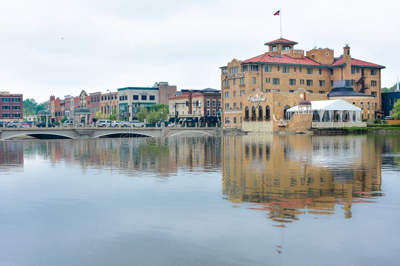 Hotel Baker - Saint Charles, Illinois. The beautiful, historical Hotel Baker and it`s reflection in the Fox River located in downtown Saint Charles, Illinois royalty free stock image
