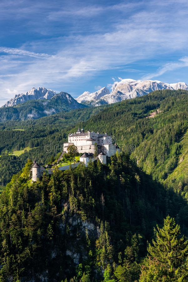 Beautiful Hohenwerfen Castle in Austria on Rocky Hill with Alps in Background royalty free stock images