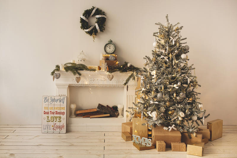 Download Beautiful Holiday Decorated Room With Christmas Tree With Presents Under It Stock Image - Image of interiors, chimney: 48361699