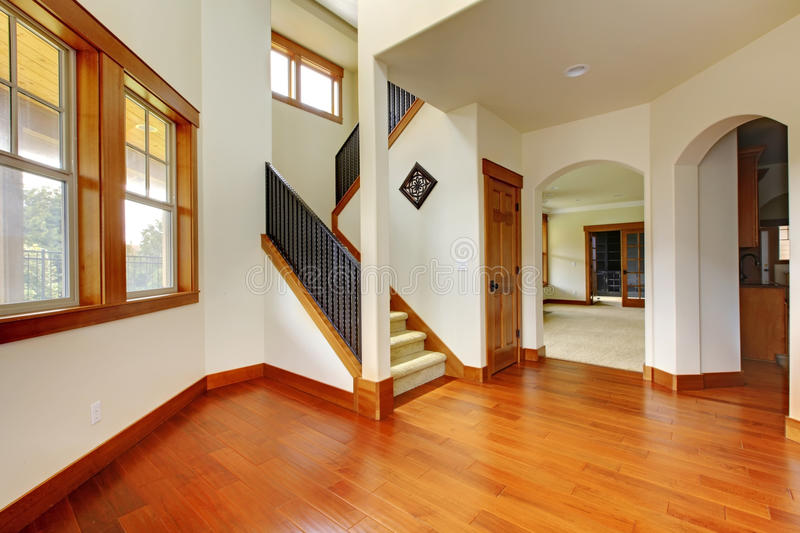Beautiful home entrance with wood floor. New luxury home interior. stock photography