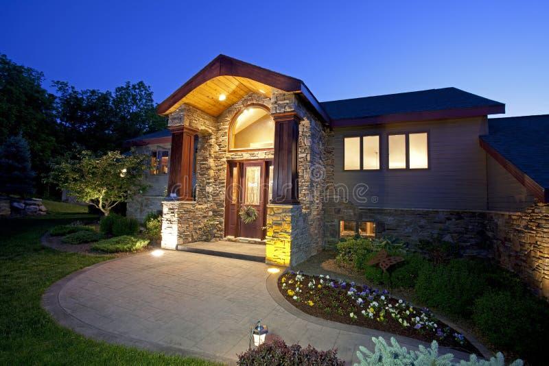 Beautiful home entryway at dusk stock photos