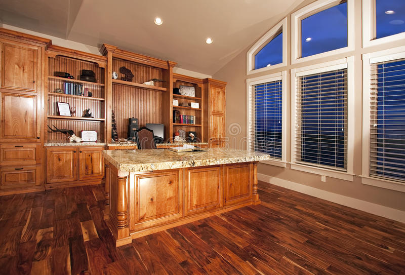 Beautiful home office with wood floors royalty free stock photography