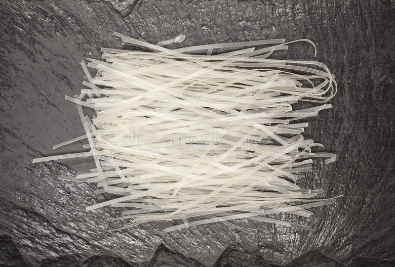 Beautiful homemade Japanese rice noodles from durum wheat on stone background, closeup stock images