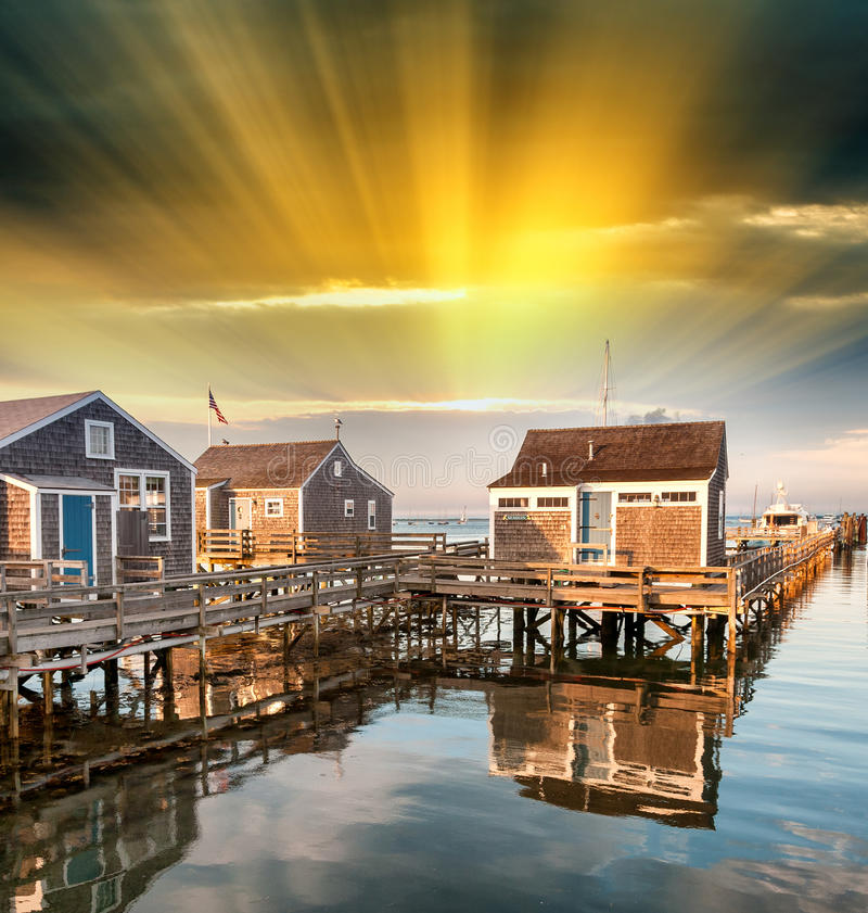 Beautiful homes of Nantucket, Massachusetts. Houses over water a. T dusk stock photos