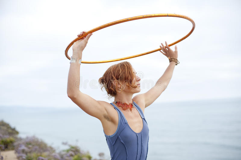 Beautiful Hoop Woman. Beautiful woman with hoop and the sea and the sky. Contemplate Sea and Sky royalty free stock photo