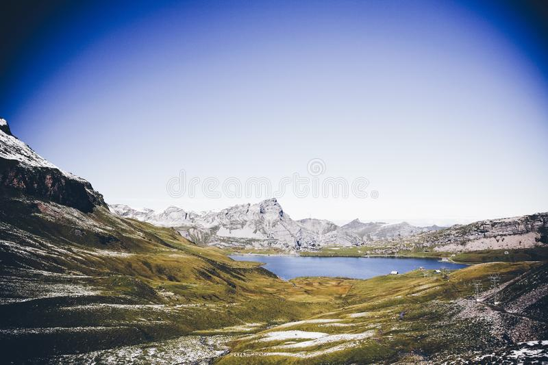 Beautiful horizontal shot of mountains near the body of water during daytime. A beautiful horizontal shot of mountains near the body of water during daytime royalty free stock photo