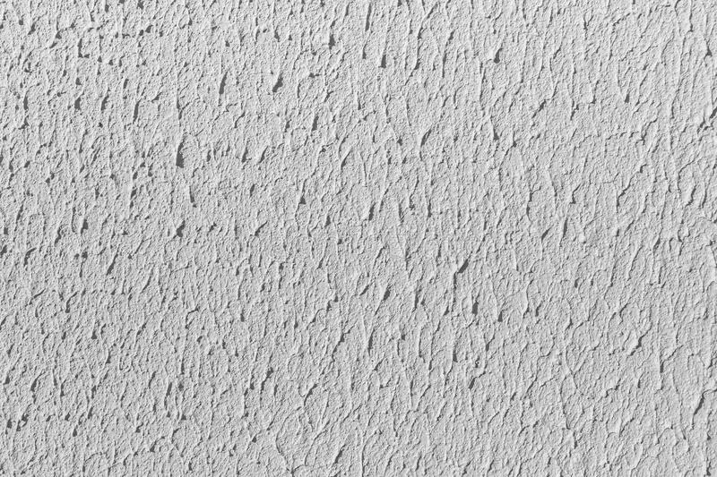 Beautiful horizontal texture of part of old concrete wall painted in gray and white color and with holes on the photo. Beautiful horizontal texture of part of stock images