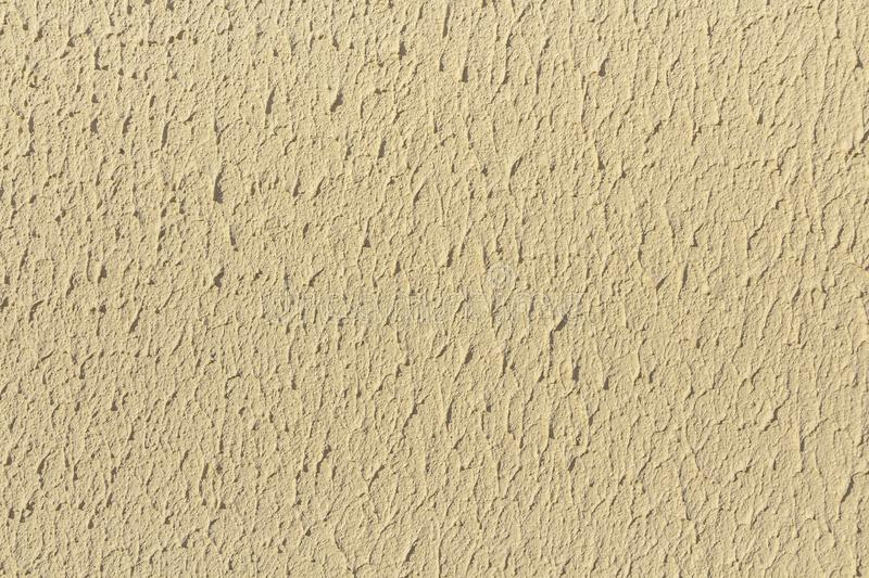Beautiful horizontal texture of part of old concrete wall painted in yellow and white color and with holes on the photo. Beautiful horizontal texture of part of royalty free stock image