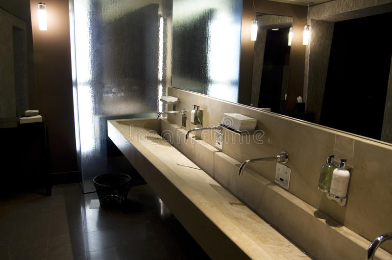 Beautiful hotel bathroom interiors. Nice lighting and interiors in a luxury hotel bathroom stock images