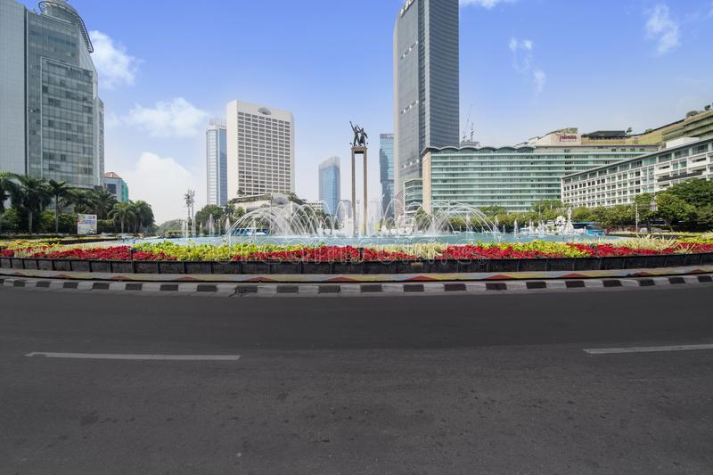 Beautiful Hotel Indonesia roundabout under blue sky royalty free stock photography