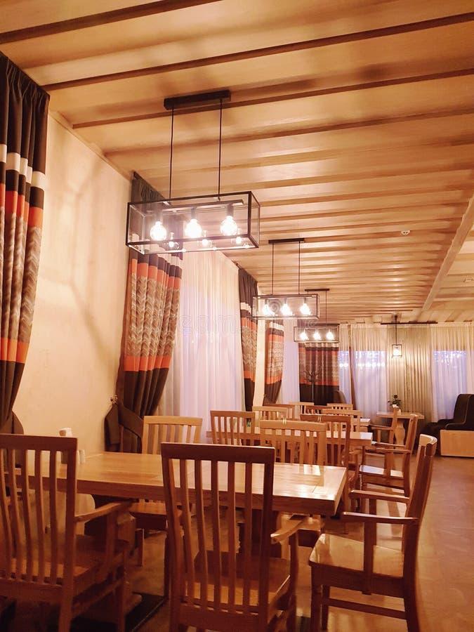 Restaurant in modern hotel in ski resort Bukovel. Beautiful  hotel  ski resort  chalets  bukovel carpathian s  carpathians ukraine amazing winter wood   wooden stock images
