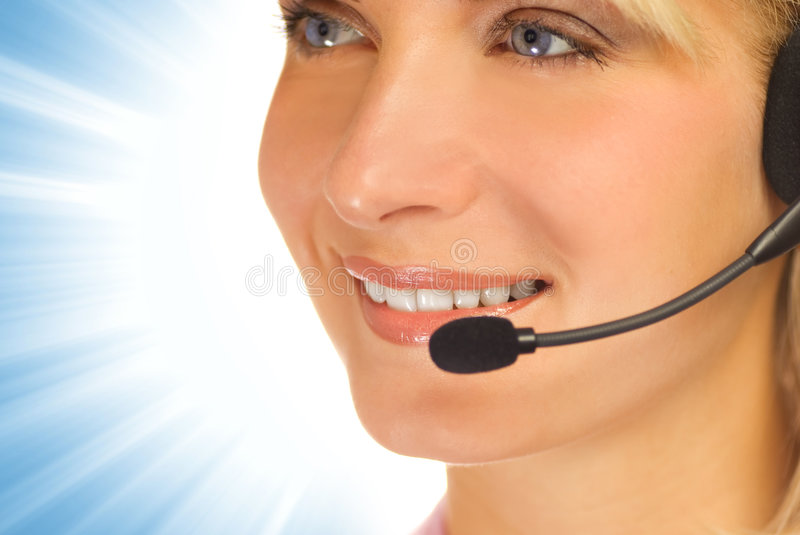 Beautiful hotline operator. With headset on abstract background stock photography