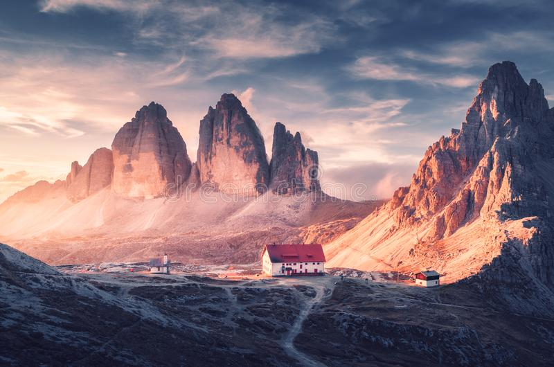 Beautiful house and church in mountain valley at sunset stock photo