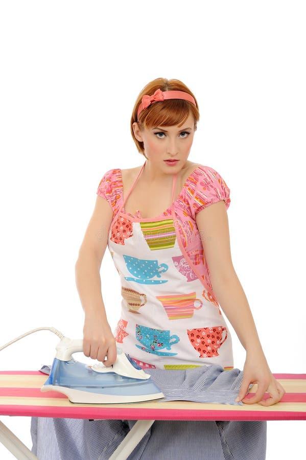 Beautiful house woman ironing . isolated