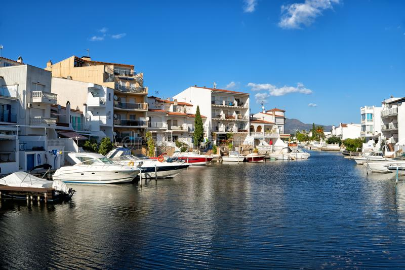 Beautiful houses and hotels on the shores of canal in Empuriabrava royalty free stock image