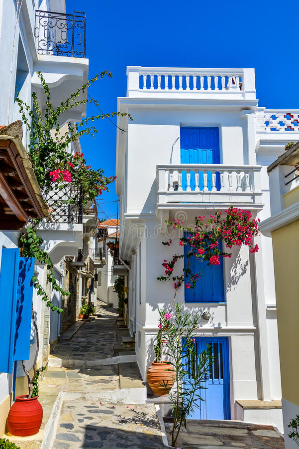 Beautiful houses on a narrow street in Skopelos old town, Greece royalty free stock image
