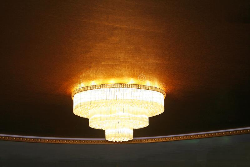 Beautiful huge golden chandelier royalty free stock photos