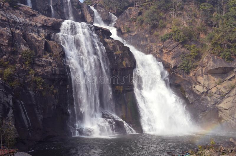 Beautiful huge Hundru waterfall of Ranchi ,india. Beautiful cascade with huge white water bodies, the massive Hundru waterfall of ranchi, it is the 34th highest royalty free stock photos