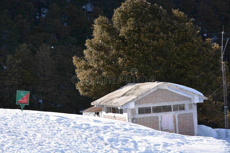 A BEAUTIFUL HUT AMIDST SNOW FALL OF JOSHIMATH. A BEAUTIFUL HUT AMIDST SNOW FALL OF OF JOSHIMATH INDIA IN PEAK WINTER royalty free stock image