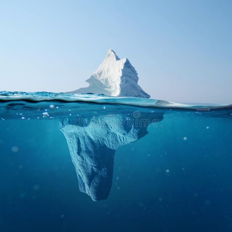 Beautiful iceberg in the ocean with a view under water. Global warming concept. Melting glacier. royalty free stock images