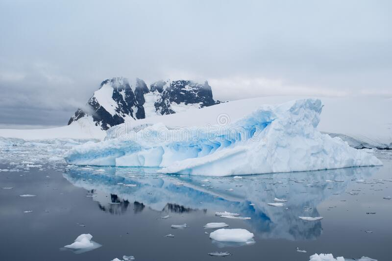 Beautiful iceberg in the ocean with a view under water. Global warming concept. Melting glacier stock photography
