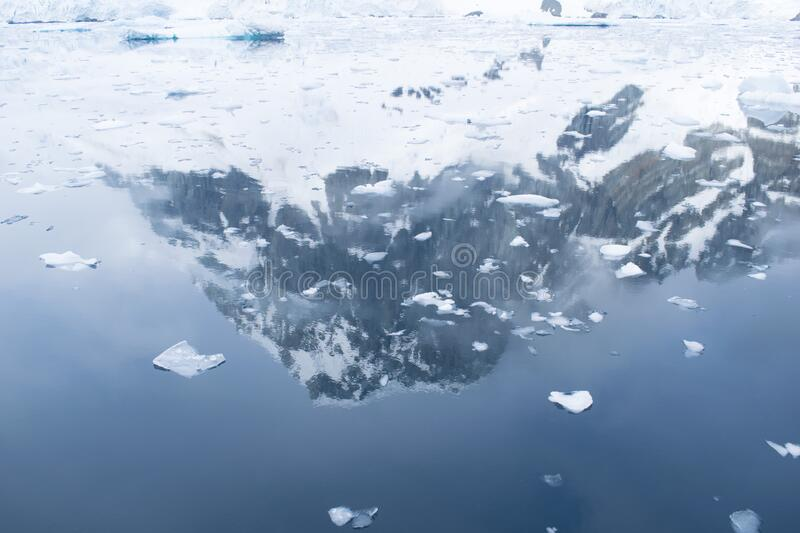Beautiful iceberg in the ocean with a view under water. Global warming concept. Melting glacier royalty free stock photo