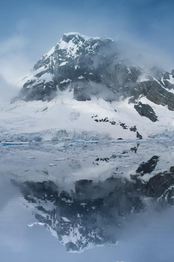 Beautiful iceberg in the ocean with a view under water. Global warming concept. Melting glacier royalty free stock image