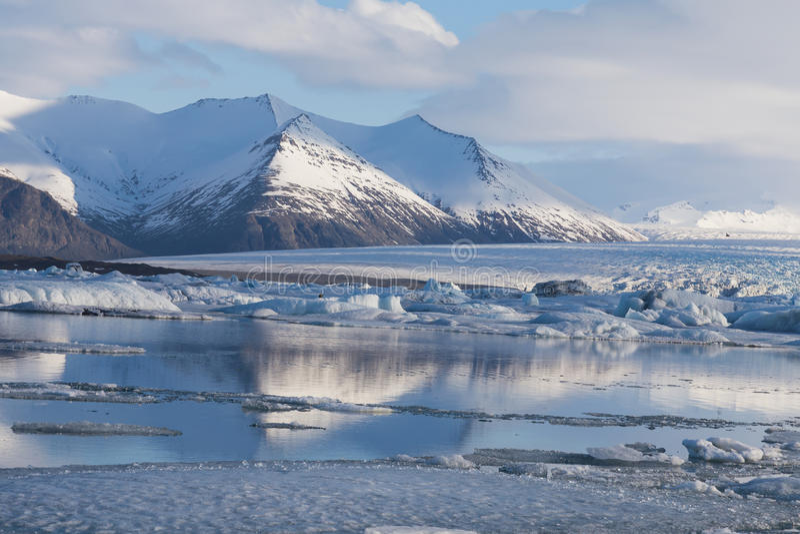 Beautiful Iceland winter season natural landscape. Over Jakulsarlon glacier and blue sky background stock image