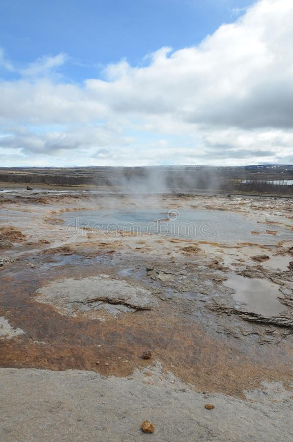 Beautiful Icelandic geysir with mineral deposits surrounding it royalty free stock photos
