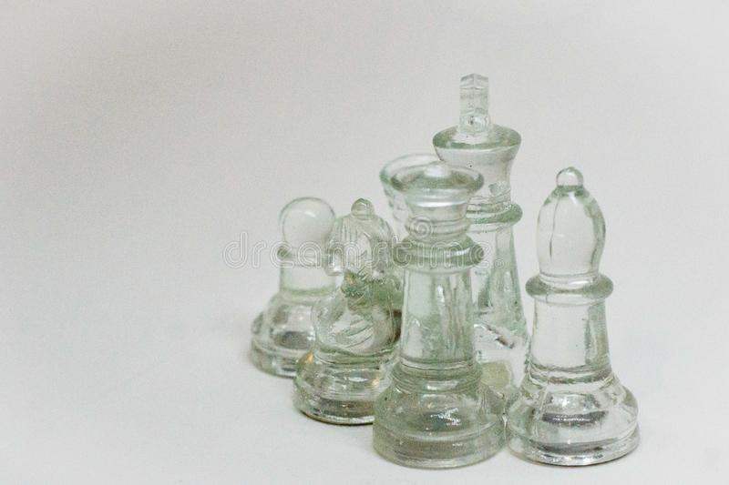 Dramatic, Chess pieces on a white Background stock image