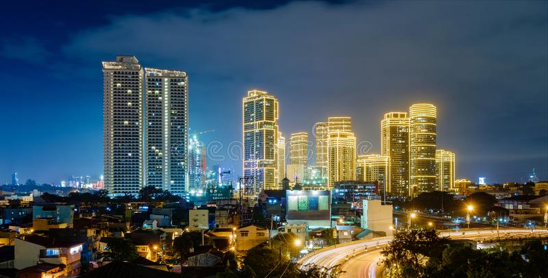 Beautiful illuminated Manila city at night. With illuminated modern buildings stock images