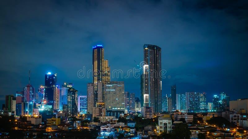 Illuminated Manila city at night. Beautiful illuminated Manila city at night with illuminated modern buildings royalty free stock photos