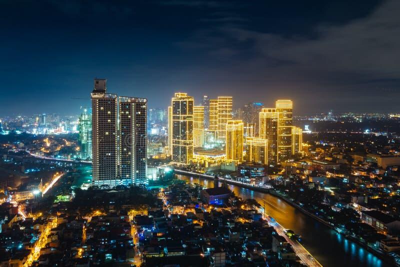 Illuminated Manila city at night. Beautiful illuminated Manila city at night with illuminated modern buildings and reflection on river royalty free stock photo