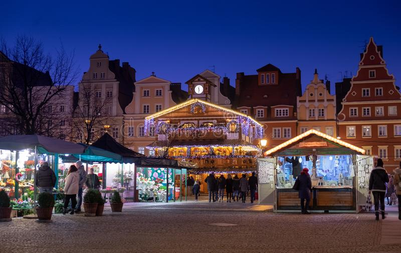 Beautiful illuminated wooden pavilion at traditional Christmas market at Wroclaw. Night time. Poland royalty free stock images