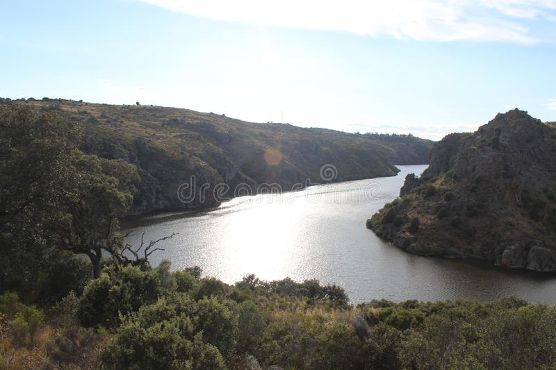 Beautiful image with a large river and some huge ravines royalty free stock image