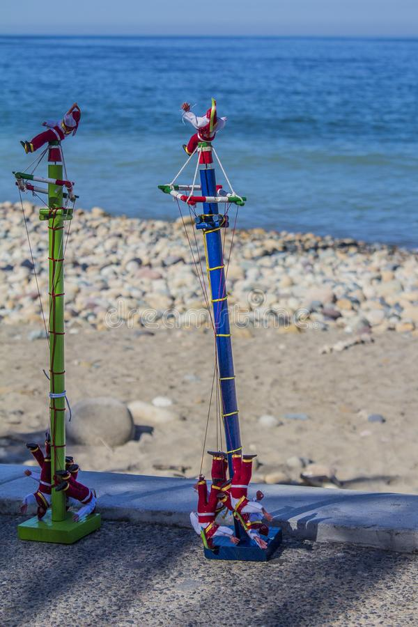 Beautiful image of Mexican toys, two small replicas of Papantla Flyers or flying pole made in wood. Beautiful image of Mexican toys, two small replicas of royalty free stock photos