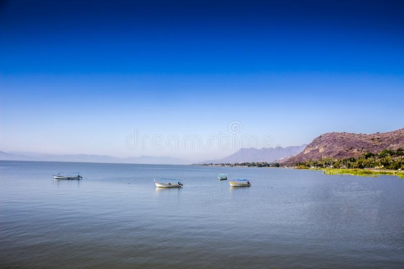 Beautiful image of motorboats on the lake of Chapala. With a blue sky on a wonderful and sunny day in the state of Jalisco Mexico stock photos