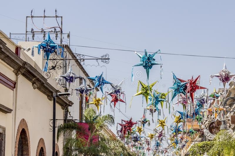 Beautiful image of piñatas suspended on a street. In Tlaquepaque Jalisco Mexico on a wonderful sunny day stock photography