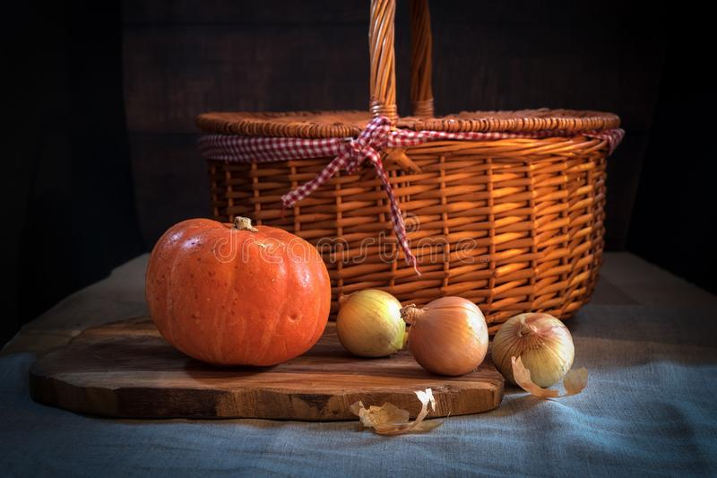 Beautiful image of pumpkin with onions and basket. food background, food photography. nutritional and delicious conceptual image o. F healthy lifestyle. good for stock photos