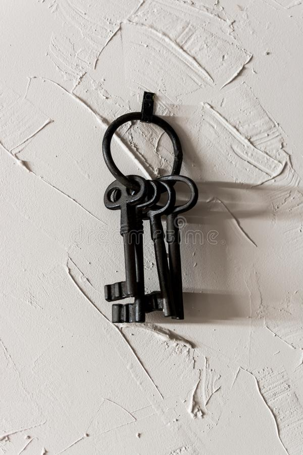 Old keys in the wall stock photo