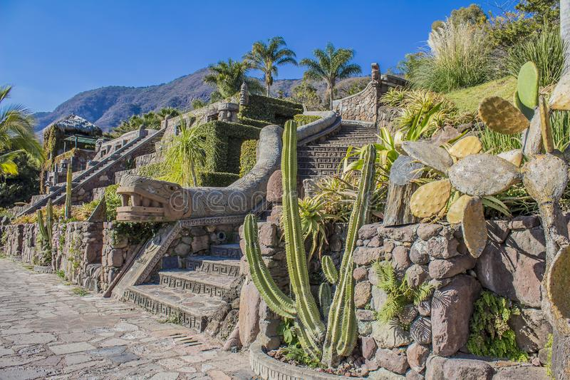 Image of a staircase in a garden with the replica of the plumed feathered serpent. Beautiful image of a staircase in a garden with the replica of the plumed royalty free stock images