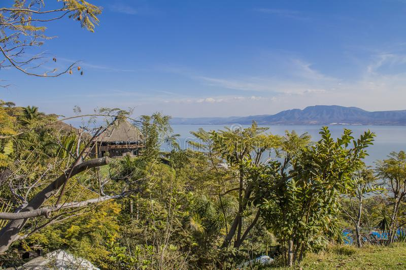 Beautiful image of a terrace on the top of a hill surrounded by green vegetation. With mountains and the lake of Chapala in the background in the state of stock photos