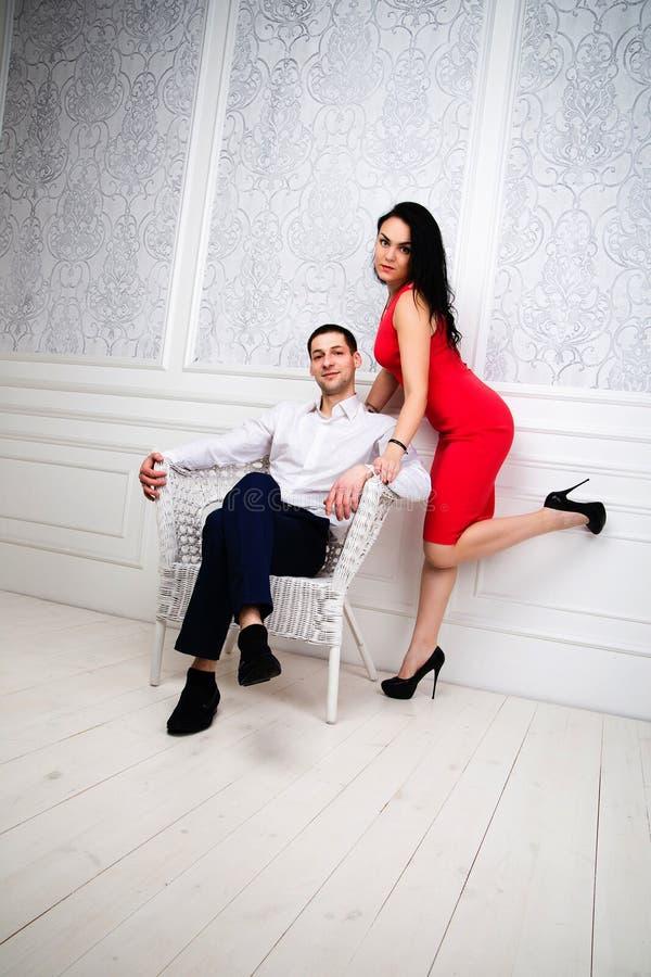 Beautiful impassioned couple, wears elegant clothes. Studio photo of beautiful impassioned couple, wears elegant clothes royalty free stock photos