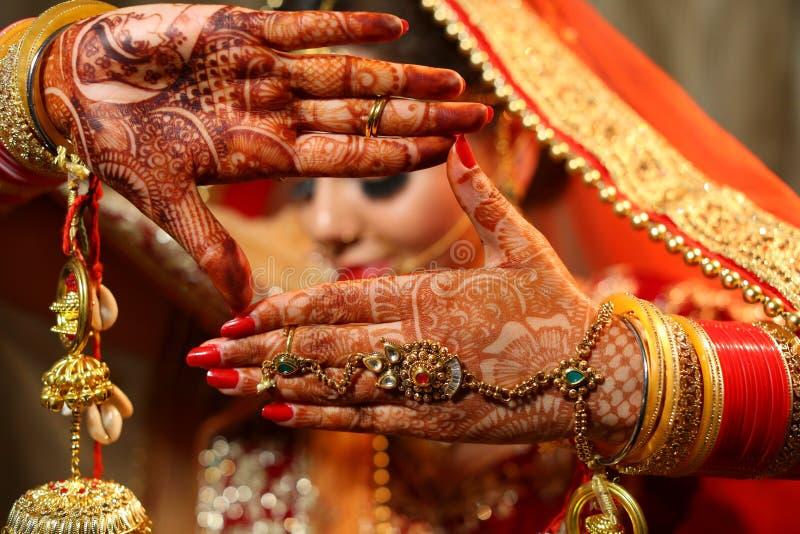 Beautiful Indian bride hands henna design hand jewelry and kalira stock photo