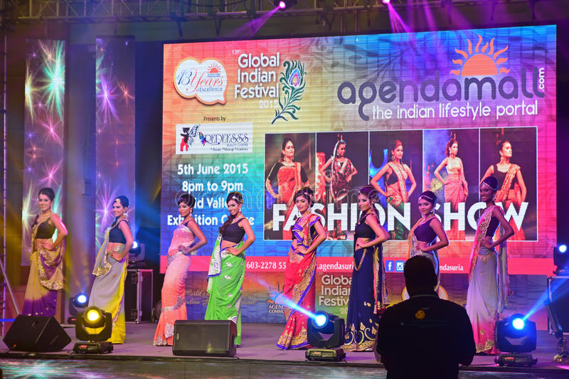 Beautiful Indian descendant models at work during Fashion Show for the Global Indian Festival 2015 held in Mid Valley Megamall royalty free stock photos